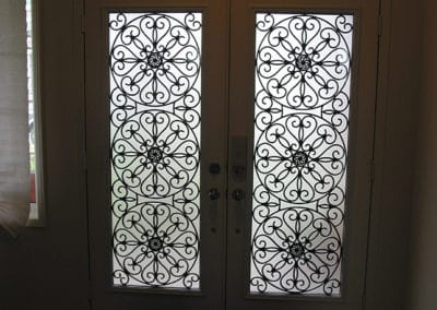 Eclipse wrought iron design by What A Pane