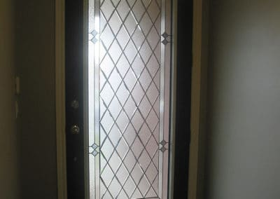 Prisma Stained Glass door inserts by What A Pane.