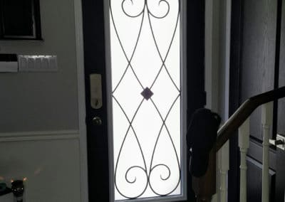 Wrought Iron door insert by What A Pane