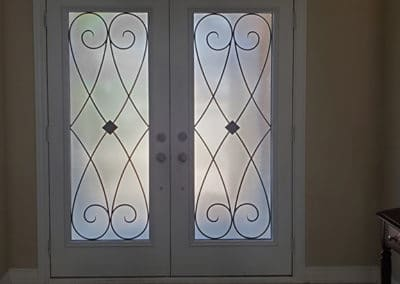 Elegab=nce wrought iron insert by What A Pane